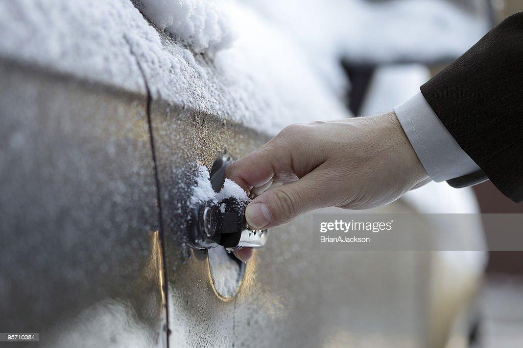 Unlocking a frozen car door : Stock Photo