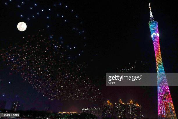 1000 unmanned aerial vehicles perform in the sky beside the Canton Tower during a performance for Lantern Festival at Haixinsha Park on February 11...