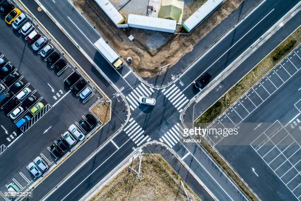 unmanned parking lot and parking lot where lots of cars are parked. - intersection stock pictures, royalty-free photos & images
