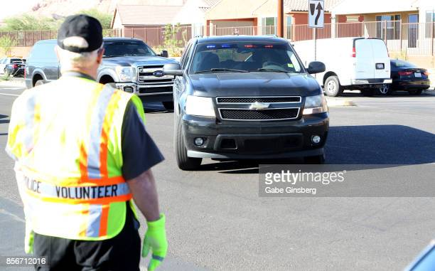 Unmarked law enforcement vehicles arrive at the Sun City Mesquite community where suspected Las Vegas gunman Stephen Paddock lived on October 2 2017...