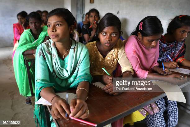 Unmarried adolescent girls ages 15 to 19 from the Mahadalit community attend a Pathfinder International training about adolescent sexual and...
