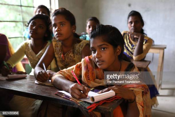 Unmarried adolescent girls participate in a lifeskills program organized by Pathfinder International These trainings organized by Pathfinder...