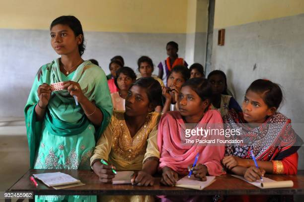 Unmarried girls ages 15 to 19 attend a Pathfinder International training about adolescent sexual and reproductive health Discussion of issues related...