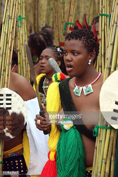 Unmarried women from Swaziland sing and dance carrying bundles of reeds at the Ludzidzini Royal Residence near the capital Mbabane on August 28...