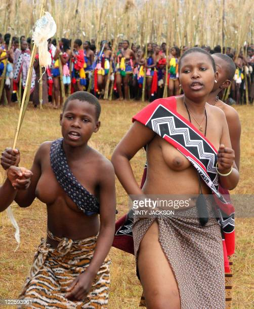 Unmarried women from Swaziland sing and dance with some carrying bundles of reeds at the Ludzidzini Royal Residence near the capital Mbabane on...
