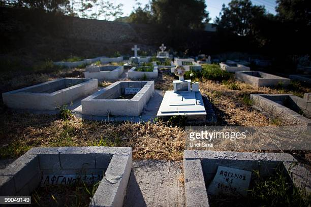 Unnamed graves of Afghan migrants stand in the corner of a cemetery on May 2 2010 in Mytilini Lesbos Greece The cemetery contains the graves of...