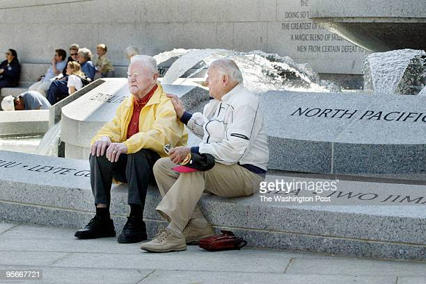 Unofficial opening of the WWII Memorial William O Abernathy and George Lynch sitting at the edge of one of the fountains The pair lives in the Armed...
