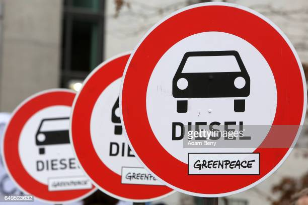 Unofficial traffic signs expressing the danger of diesel cars are seen at a demonstration outside a German federal parliament or Bundestag hearing on...