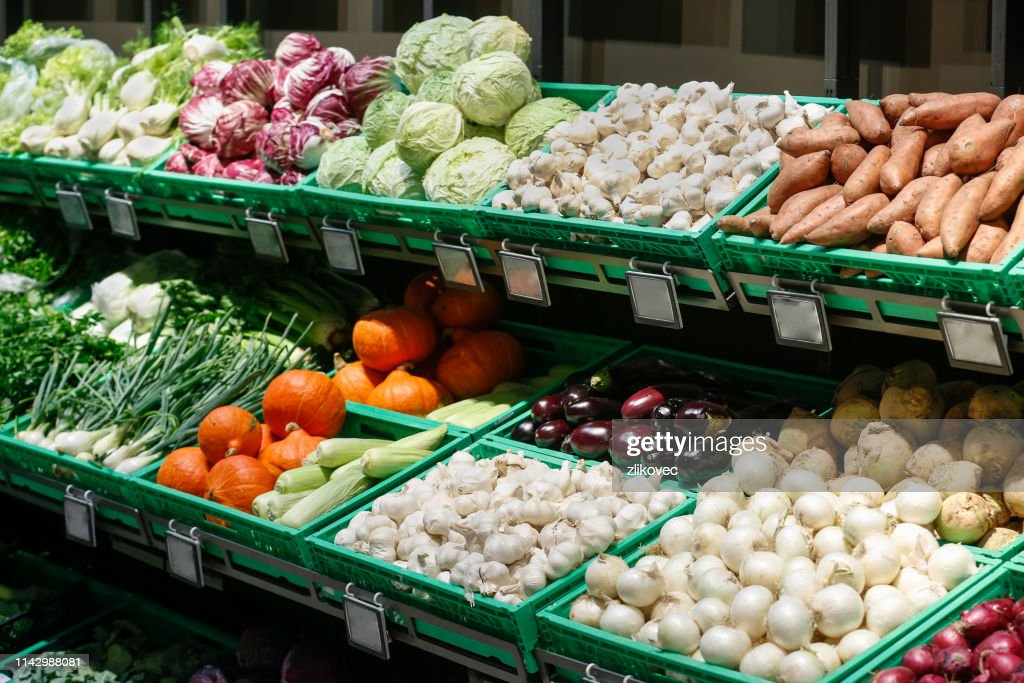 Unpacked, fresh vegetables in a self-service supermarket. : Stock Photo