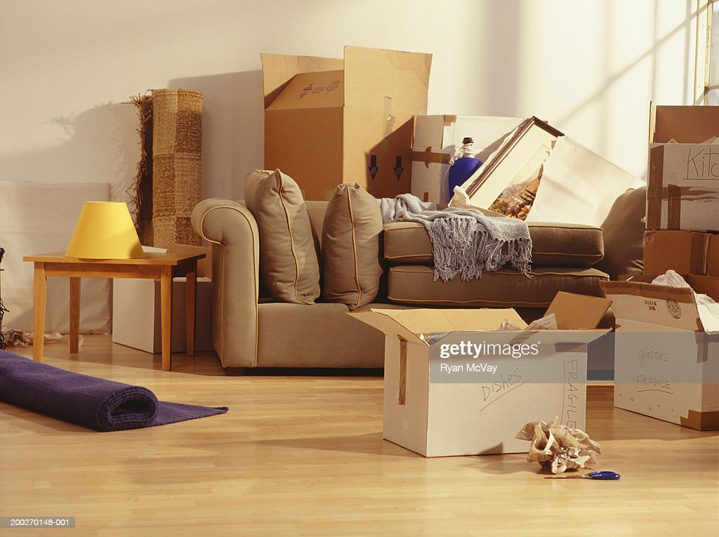 Unpacked moving boxes in Living Room : Stock Photo