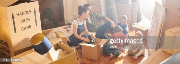 unpacking toys in the new house - sturti stock pictures, royalty-free photos & images