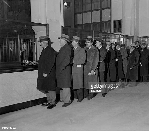 Unpaid workers line up in a Detroit bank to receive their payroll following a shipment of $30000 to be distributed by city banks to depositors...