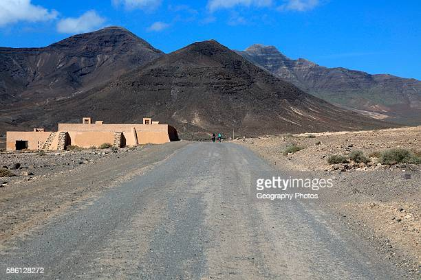 Unpaved road and mountains Jandia peninsula Fuerteventura Canary Islands Spain