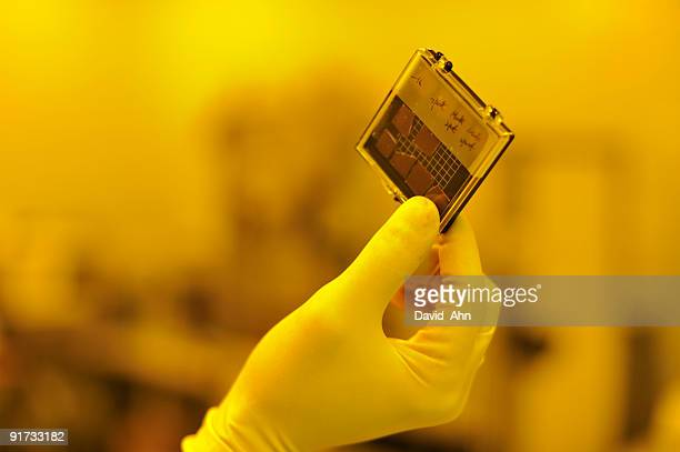 Unprocessed semicoductor wafer pieces with yellow ambient lighting, Copy Space