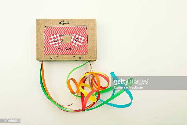 un-ravelling paper cassette tape - catherine macbride stock pictures, royalty-free photos & images