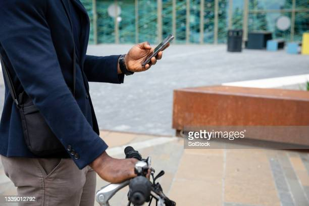 unrecognisable businessman looking for directions - green blazer stock pictures, royalty-free photos & images
