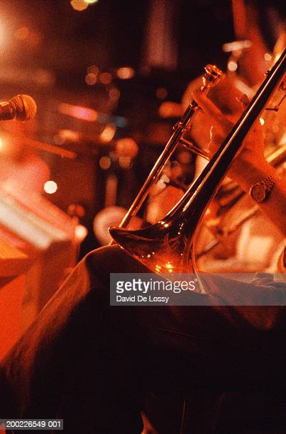 Unrecognisable person playing trombone, close-up of object