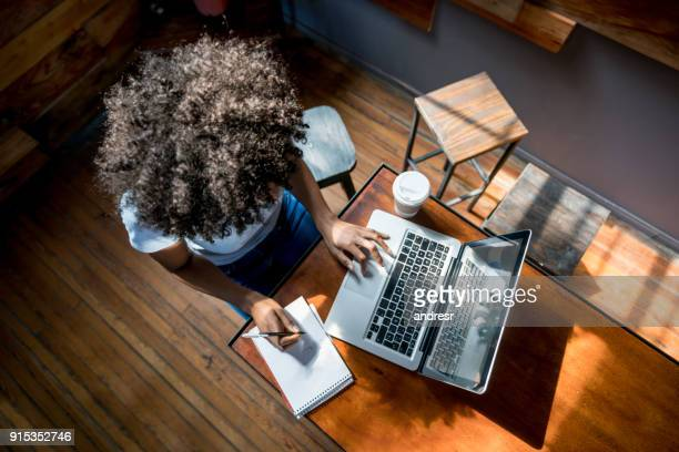 Unrecognizable african american woman studying online on her laptop