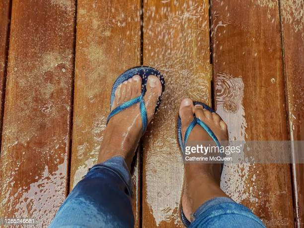 unrecognizable african-american woman washes sand off feet - open toe stock pictures, royalty-free photos & images