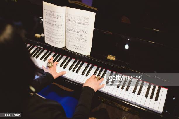 unrecognizable artist on piano - pianist stock photos and pictures