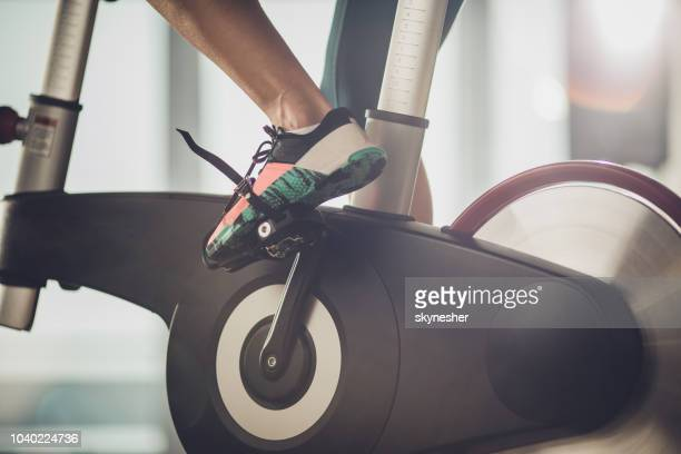unrecognizable athletic legs during exercising training in a health club. - peloton stock pictures, royalty-free photos & images