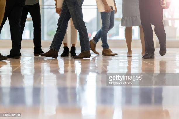 unrecognizable business people in office lobby - ankle boot stock photos and pictures