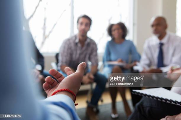 unrecognizable caucasian person gestures while speaking - staff meeting stock pictures, royalty-free photos & images
