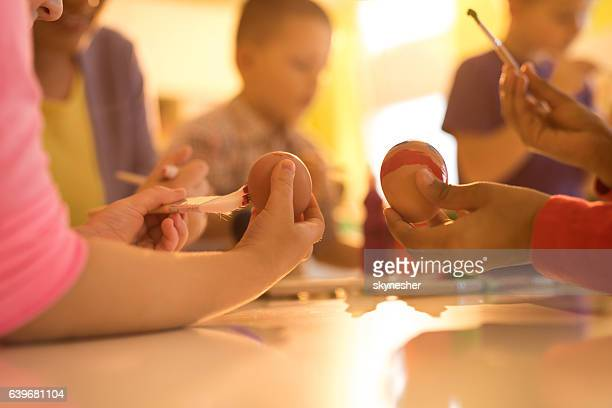 unrecognizable creative children coloring easter eggs at preschool. - african american easter stock photos and pictures