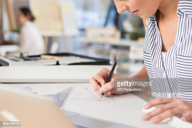 unrecognizable female architect concentrates on drawing - independence stock pictures, royalty-free photos & images