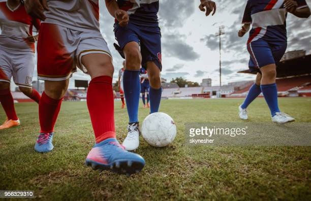 unrecognizable female soccer players in action during the match on a stadium. - soccer competition stock pictures, royalty-free photos & images