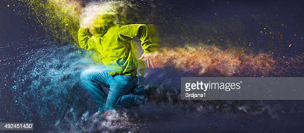 Unrecognizable Hip-hop male dancer with hoodie jumping