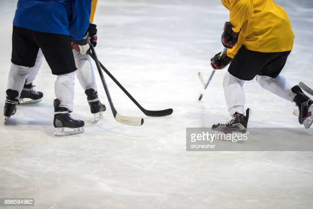 unrecognizable ice hockey player tackling his rivals on a match. - ice hockey uniform stock pictures, royalty-free photos & images
