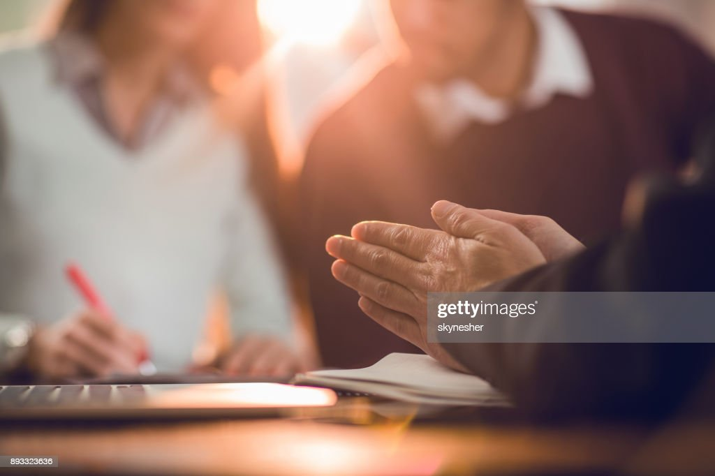 Unrecognizable insurance agent rubbing his hands while making a fraud. : Stock Photo