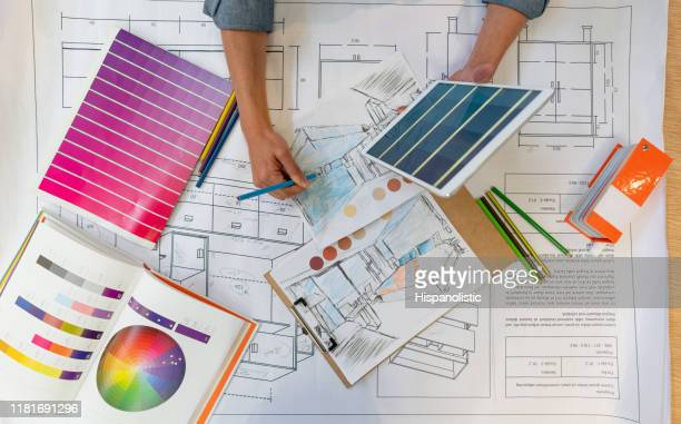 unrecognizable interior designer working on a home renovation sketch while holding a tablet - home showcase interior stock pictures, royalty-free photos & images