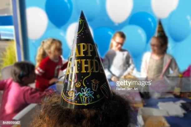 unrecognizable kids in birthday party - rafael ben ari stock-fotos und bilder