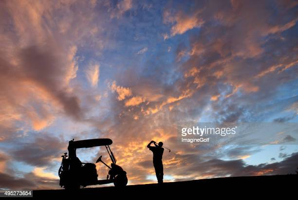 unrecognizable male senior caucasian golfer swinging against gorgeous sunset - driving range stock photos and pictures