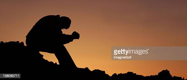unrecognizable man saying morning prayer - christianity stock pictures, royalty-free photos & images