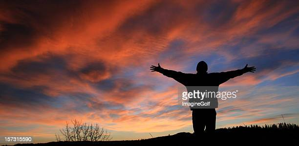 Unrecognizable Man With Arms Outstretched in Worship