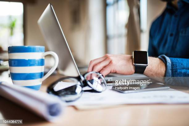 unrecognizable mature man with smart watch working at home office. - 文房具 ストックフォトと画像