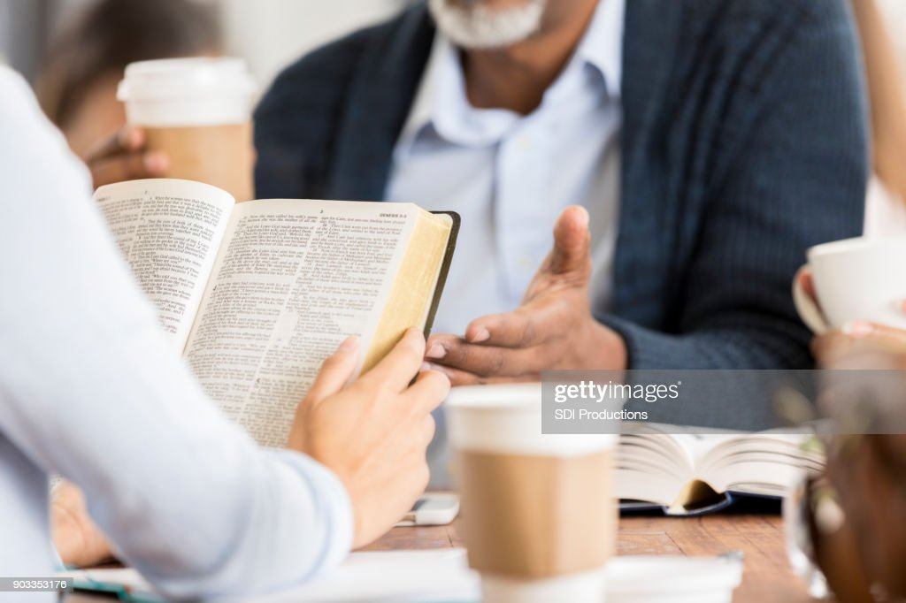 Unrecognizable people studying the Bible : Stock Photo