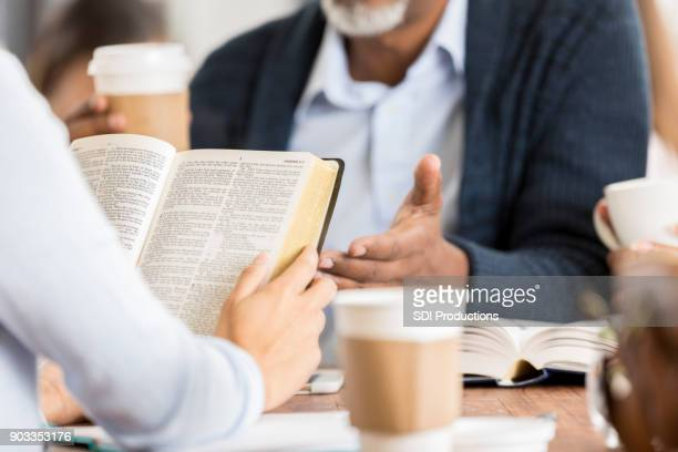 unrecognizable people studying the bible - bible photos stock pictures, royalty-free photos & images