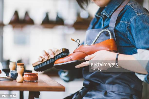 Unrecognizable person brushing shoes