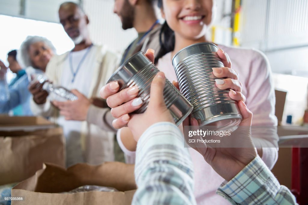 Unrecognizable person donates food during food drive : Stock Photo