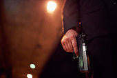 Unrecognizable person holding a handgun at night