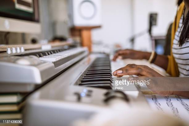 unrecognizable person playing keyboard - keyboard player stock photos and pictures