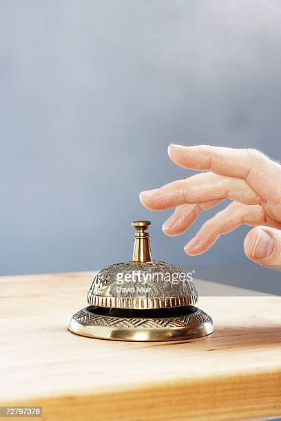Unrecognizable person ringing service bell