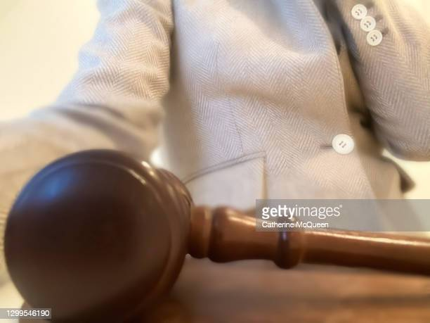 unrecognizable professional african-american woman sitting at desk behind a judge's gavel - member of congress stock pictures, royalty-free photos & images