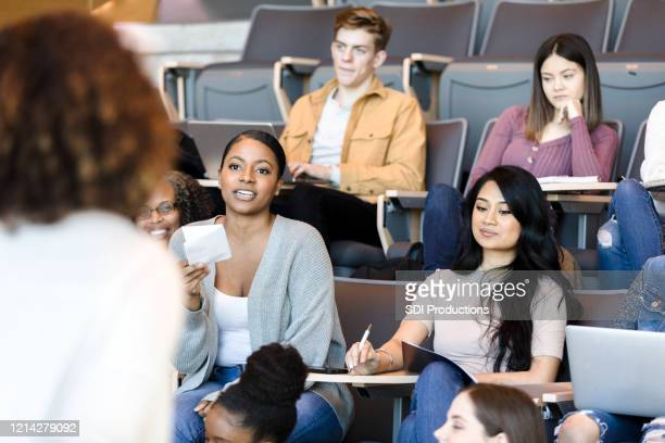 unrecognizable professor giving lecture - community college stock pictures, royalty-free photos & images