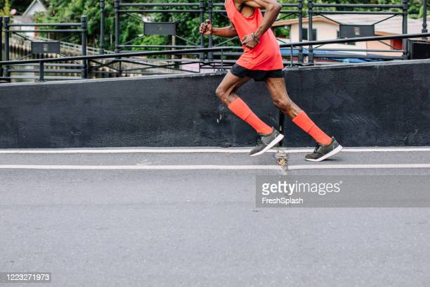 unrecognizable senior african american man running in the city - men wearing stockings stock pictures, royalty-free photos & images