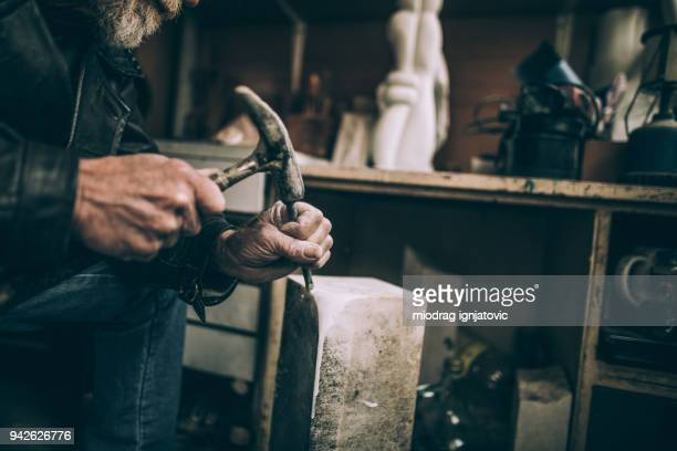 unrecognizable senior stone cutter artist - sculptor stock pictures, royalty-free photos & images
